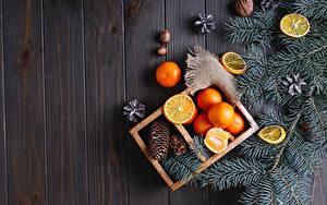 Обои для рабочего стола Рождество Мандарины Орехи Лимоны Доски Ветвь Шишка Пища