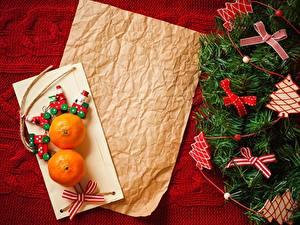 Фото Рождество Мандарины Бумаге Бантики Новогодняя ёлка Лист бумаги
