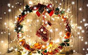 Фотографии Рождество Мандарины Доски Сапоги Гирлянда Бантик Шарики Подарков