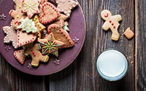 Фотографии Рождество Молоко Печенье Доски Тарелке Стакан Сердечко Пища