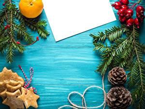 Фото Новый год Апельсин Лист бумаги Ветки Шишки Звездочки Шаблон поздравительной открытки