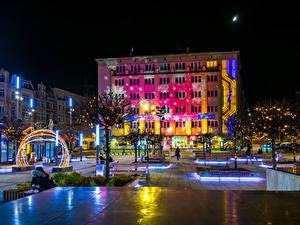 Фотография Рождество Польша Здания Городской площади Ночные Электрическая гирлянда Улице Katowice