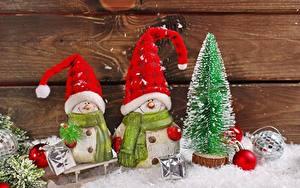 Картинки Рождество Снеговики Две Шапка Шарф