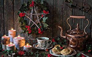 Фотография Рождество Натюрморт Чайник Печенье Свечи Ягоды Чашке Ветки Еда