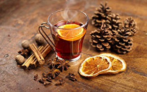 Фото Новый год Чай Лимоны Корица Бадьян звезда аниса Орехи Чашка Шишки