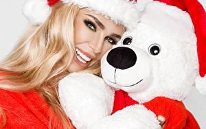 Фото Рождество Плюшевый мишка Блондинки Улыбается Смотрит Шапка