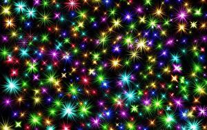Фотографии Рождество Текстура Звездочки Разноцветные Лучи света