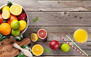 Фото Цитрусовые Лимоны Грейпфрут Сок Доски Разделочная доска Стакан Пища