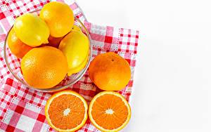 Фото Цитрусовые Лимоны Апельсин Мандарины Белом фоне