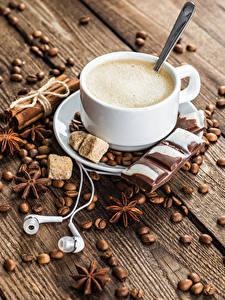 Фото Кофе Бадьян звезда аниса Корица Шоколад Капучино Доски Чашка Зерна В наушниках Сахара Пища