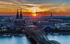 Обои Кёльн Германия Речка Мосты Собор Речные суда Рассветы и закаты Rhine