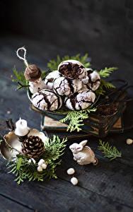 Фотографии Печенье Свечи Доски На ветке Шишки Снеговика Еда