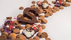 Обои для рабочего стола Печенье Шоколад Много Серый фон Еда