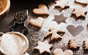 Картинки Печенье Сахарная пудра Ангелы Сердце Звездочки Ель