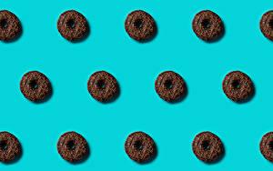 Картинка Пончики Текстура Цветной фон Пища