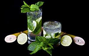 Фотографии Напитки Лайм Мохито Черный фон 2 Стакан Листва Пища