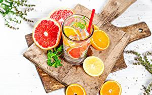 Картинка Напиток Апельсин Лимоны Грейпфрут Лимонад Разделочной доске Стакане Пища