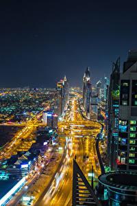 Обои Объединённые Арабские Эмираты Дубай Здания Дороги Мегаполиса В ночи Города