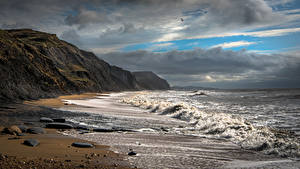 Фотографии Англия Берег Волны Облачно Charmouth Beach Природа