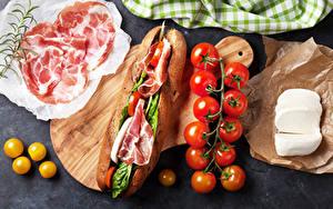 Фото Фастфуд Бутерброды Ветчина Томаты Сыры Пища