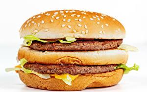 Картинки Фастфуд Гамбургер Булочки Котлеты Крупным планом Белым фоном Еда
