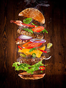 Фотографии Быстрое питание Гамбургер Булочки Овощи Мясные продукты