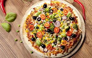 Фотографии Быстрое питание Пицца Овощи Крупным планом Продукты питания