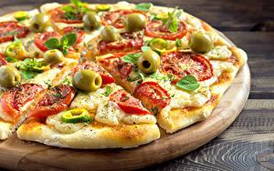 Фото Быстрое питание Пицца Вблизи Разделочная доска Пища