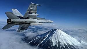 Картинка Самолеты Истребители Горы Летящий Super Hornet, F/A-18F, U.S. 7th Fleet Авиация