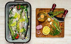 Картинка Рыба Лимоны Пряности Укроп Чеснок Разделочная доска Пища
