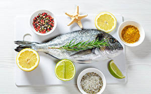 Картинка Рыба Лимоны Пряности Бадьян звезда аниса Лайм Пища