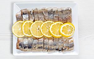 Фотографии Рыба Лимоны Нарезка herring