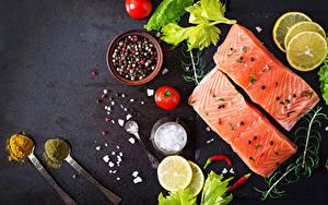 Фотография Рыба Приправы Томаты Лимоны Ложка Пища