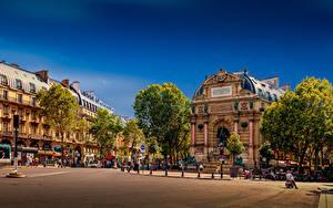 Фото Франция Здания Памятники Париже Уличные фонари Улице Городской площади Place Saint-Michel город