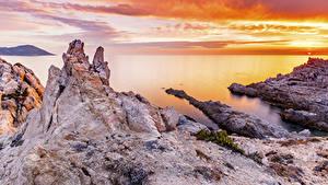 Фото Франция Рассвет и закат Берег Залив Скала Calvi Corse Природа