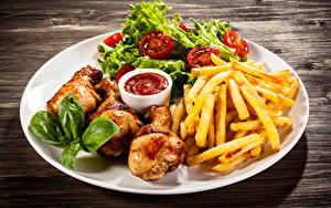 Картинки Картофель фри Курица запеченная Овощи Тарелка Кетчуп