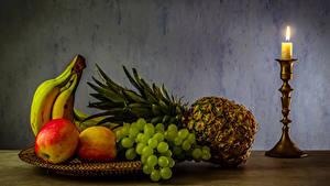 Картинки Фрукты Свечи Ананасы Бананы Яблоки Виноград Еда