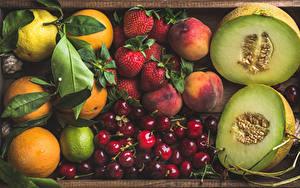 Обои Фрукты Дыни Вишня Персики Клубника Цитрусовые Ягоды Продукты питания