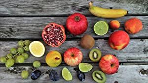 Фото Фрукты Гранат Яблоки Виноград Лимоны Бананы Продукты питания