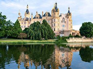 Обои для рабочего стола Германия Замки Озеро Schwerin castle город