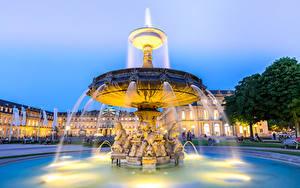 Картинки Германия Дома Фонтаны Вечер Скульптуры Stuttgart city center Города