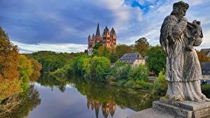 Картинки Германия Речка Осень Собор Скульптуры Башня Saint George's Cathedral, Hessen город