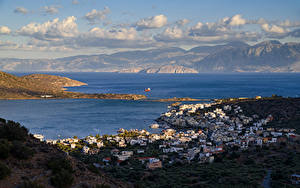 Картинки Греция Дома Море Гора Облачно Elounda Beach город