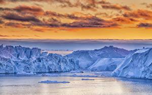 Картинки Гренландия Небо Айсберги Залива Скала Облака