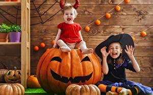 Фотографии Хеллоуин Тыква Ведьма Девочки Два Шляпа Дети