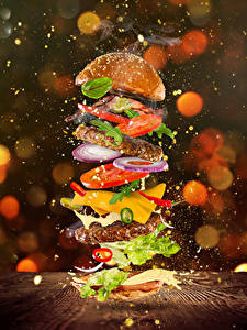 Фотографии Гамбургер Булочки Мясные продукты Овощи Сыры Брызги Еда