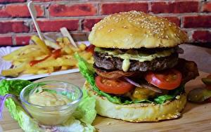 Фото Гамбургер Фастфуд Овощи Булочки Продукты питания