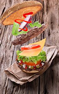 Картинки Гамбургер Котлеты Сыры Овощи Доски Продукты питания