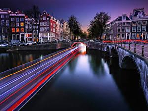 Фотографии Здания Мост Нидерланды Реки Амстердам Ночь Водный канал Едет Города