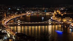 Обои для рабочего стола Венгрия Будапешт Дома Реки Мост Ночные Уличные фонари город